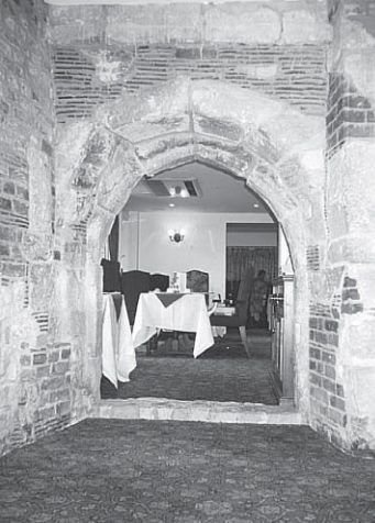 13th century doorway in west wall of old Priory, discovered in the 1940s (Whitbread Archive)