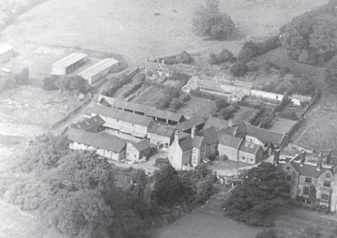 Aerial view, 1969, showing buildings and kitchen garden to the west of the house (Genius Photography)